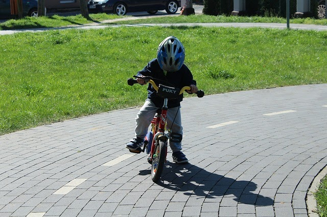 child learning to ride